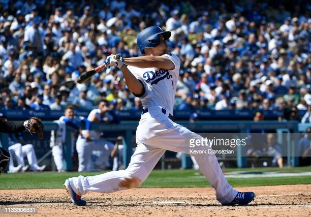 Corey Seager of the Los Angeles Dodgers hits a one run home run against pitcher Zack Greinke of the Arizona Diamondbacks during the fourth inning...