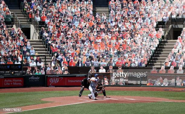 Corey Seager of the Los Angeles Dodgers hits a single in the first inning against the San Francisco Giants at Oracle Park on August 27, 2020 in San...