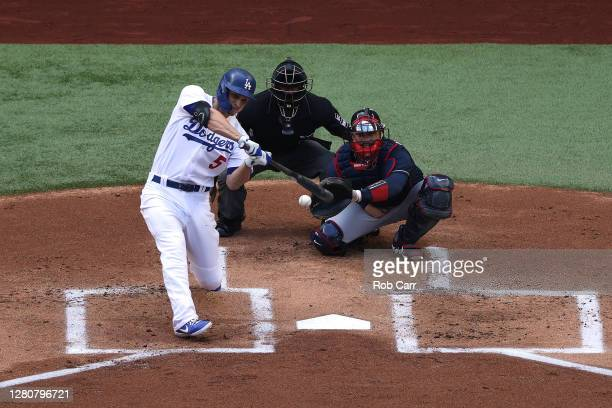 Corey Seager of the Los Angeles Dodgers hits a solo home run against the Atlanta Braves during the first inning in Game Six of the National League...