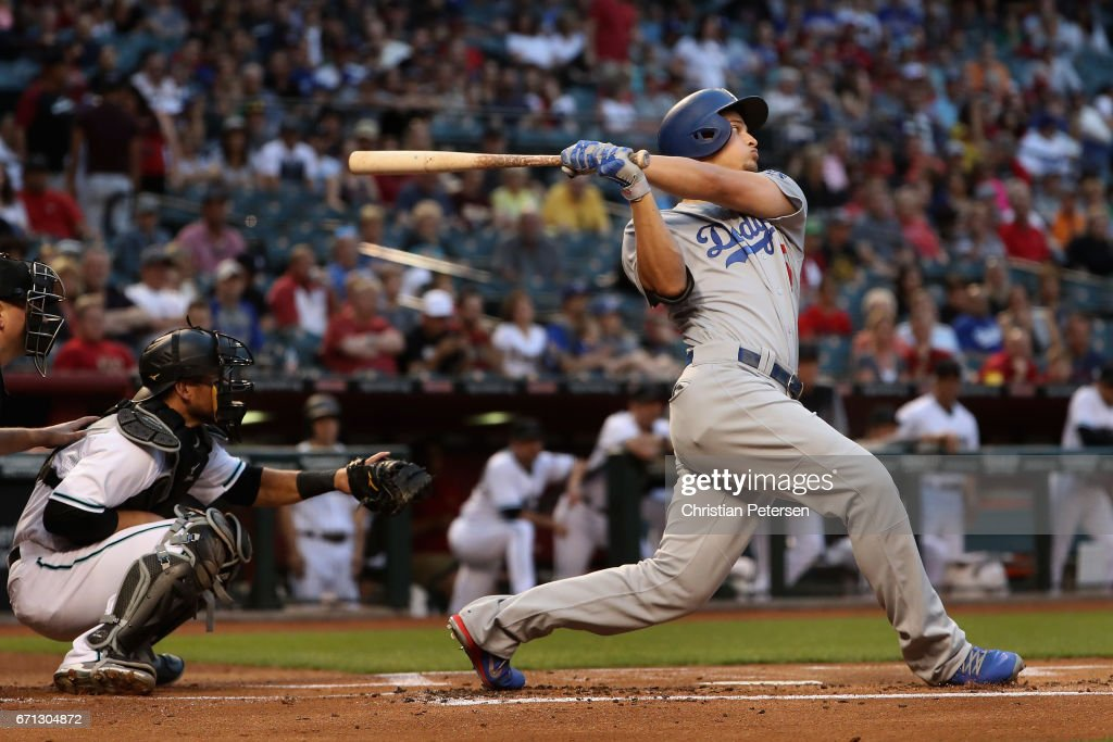 Corey Seager #5 of the Los Angeles Dodgers hits a two run home run against the Arizona Diamondbacks during the first inning of the MLB game at Chase Field on April 21, 2017 in Phoenix, Arizona.