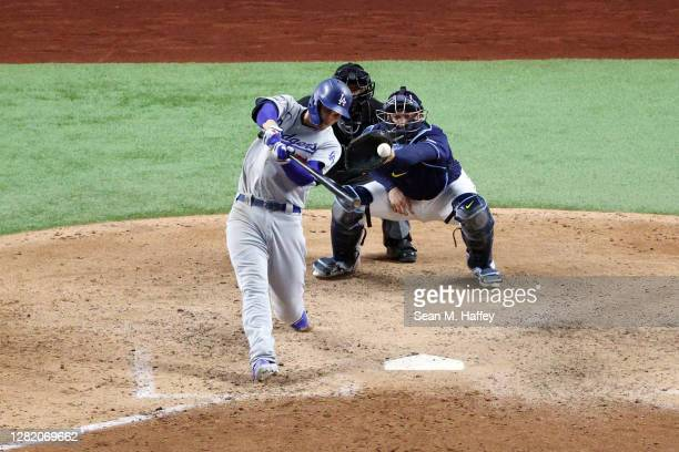 Corey Seager of the Los Angeles Dodgers hits an RBI single against the Tampa Bay Rays during the eighth inning in Game Four of the 2020 MLB World...