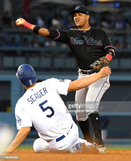 Corey Seager of the Los Angeles Dodgers is out at second as Starlin Castro of the Miami Marlins throws to first for a double play to end the sixth...