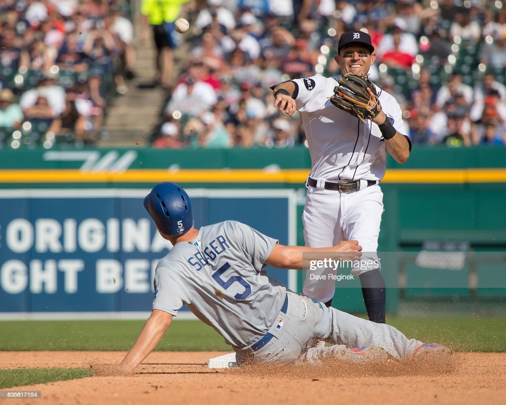 Corey Seager #5 of the Los Angeles Dodgers is out at second base as Ian Kinsler #3 of the Detroit Tigers turns a double play in the fourth inning during a MLB game at Comerica Park on August 19, 2017 in Detroit, Michigan.