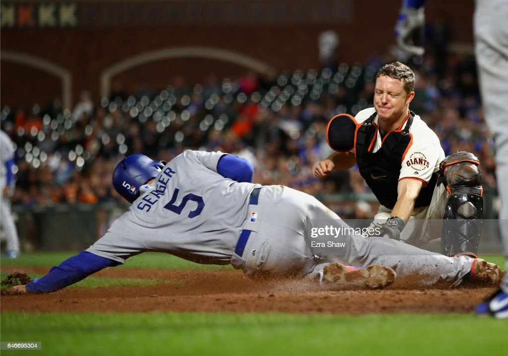 Corey Seager #5 of the Los Angeles Dodgers is tagged out by Nick Hundley #5 of the San Francisco Giants in the ninth inning at AT&T Park on September 13, 2017 in San Francisco, California.
