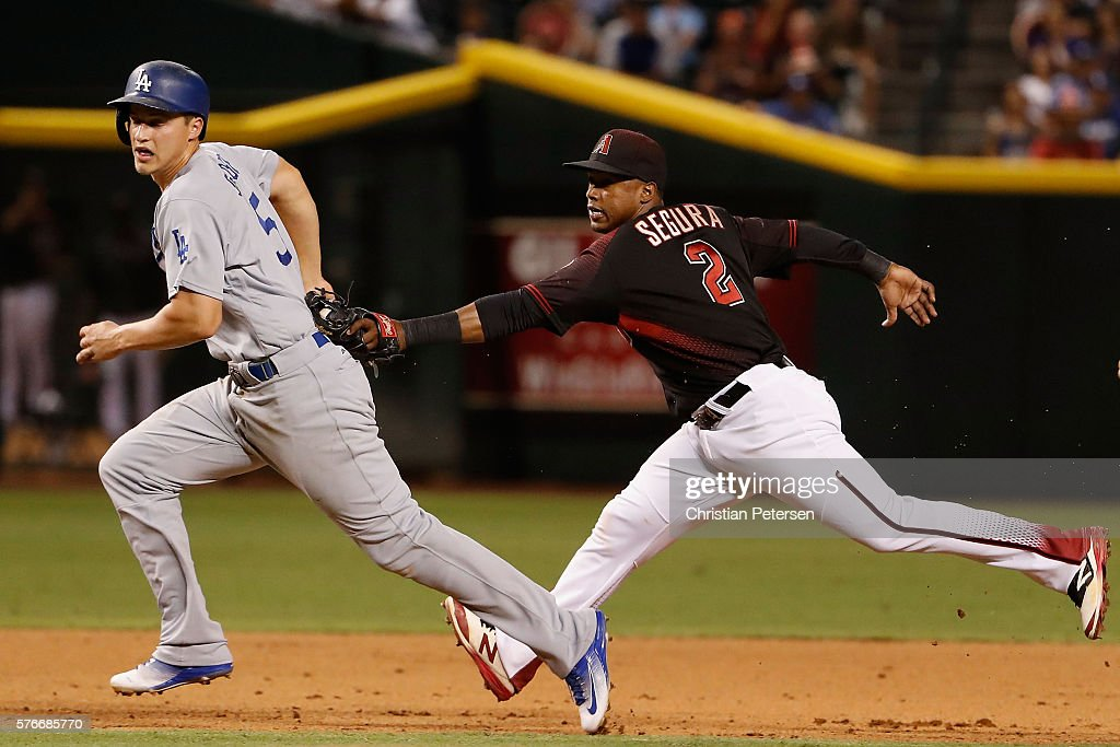 Corey Seager #5 of the Los Angeles Dodgers is tagged out in a run down by infielder Jean Segura #2 of the Arizona Diamondbacks during the MLB game at Chase Field on August 16, 2016 in Phoenix, Arizona. The Diamondbacks defeated the Dodgers 2-1.