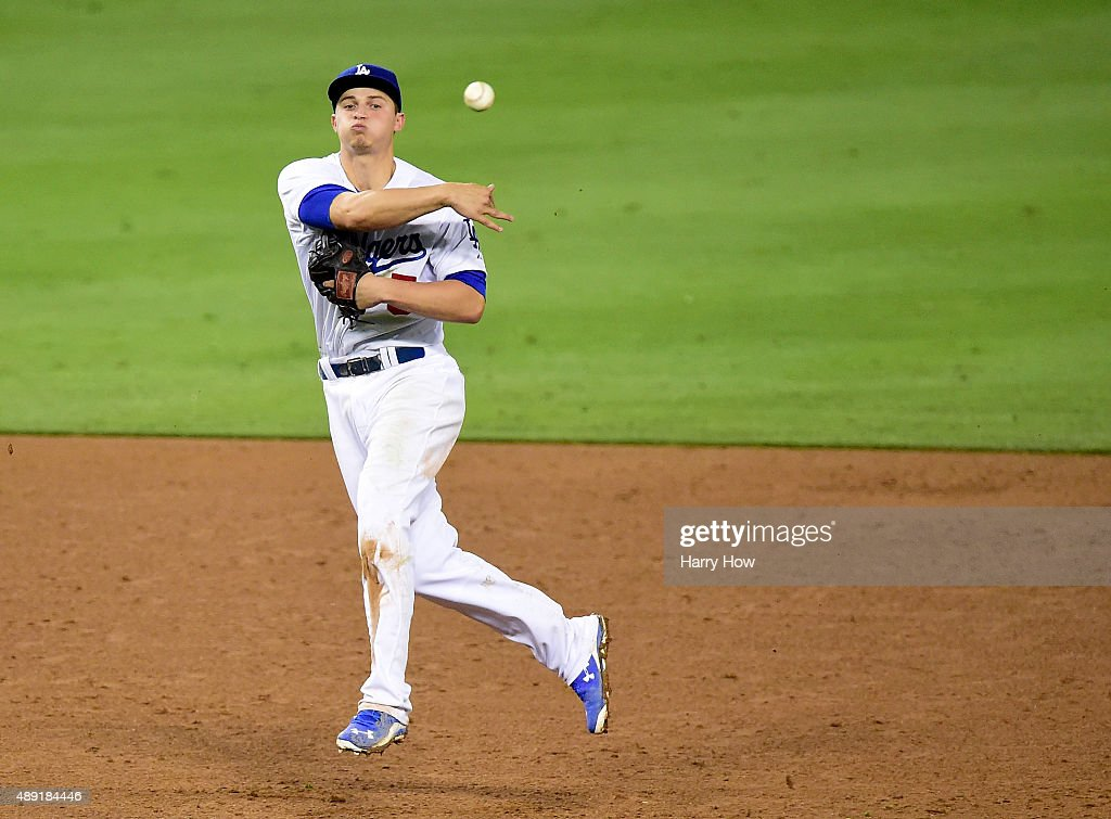 Corey Seager #5 of the Los Angeles Dodgers makes a play to first for an out during the game against the Colorado Rockies at Dodger Stadium on September 15, 2015 in Los Angeles, California.