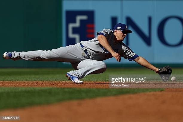 Corey Seager of the Los Angeles Dodgers misses a ball hit by Trea Turner of the Washington Nationals in the third inning during game two of the...