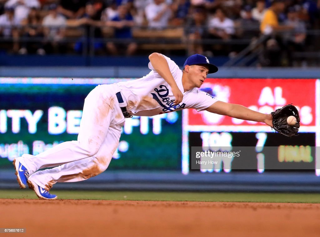 Corey Seager #5 of the Los Angeles Dodgers misses a groundball through the infield for a single to Joe Panik #12 of the San Francisco Giants during the second inning at Dodger Stadium on May 1, 2017 in Los Angeles, California.