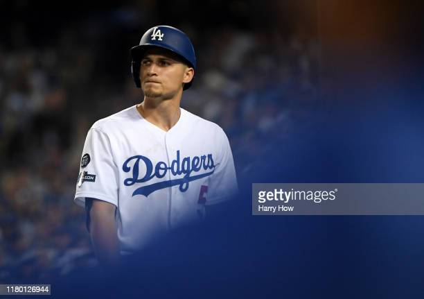 Corey Seager of the Los Angeles Dodgers reacts after striking out in the sixth inning of game five of the National League Division Series against the...
