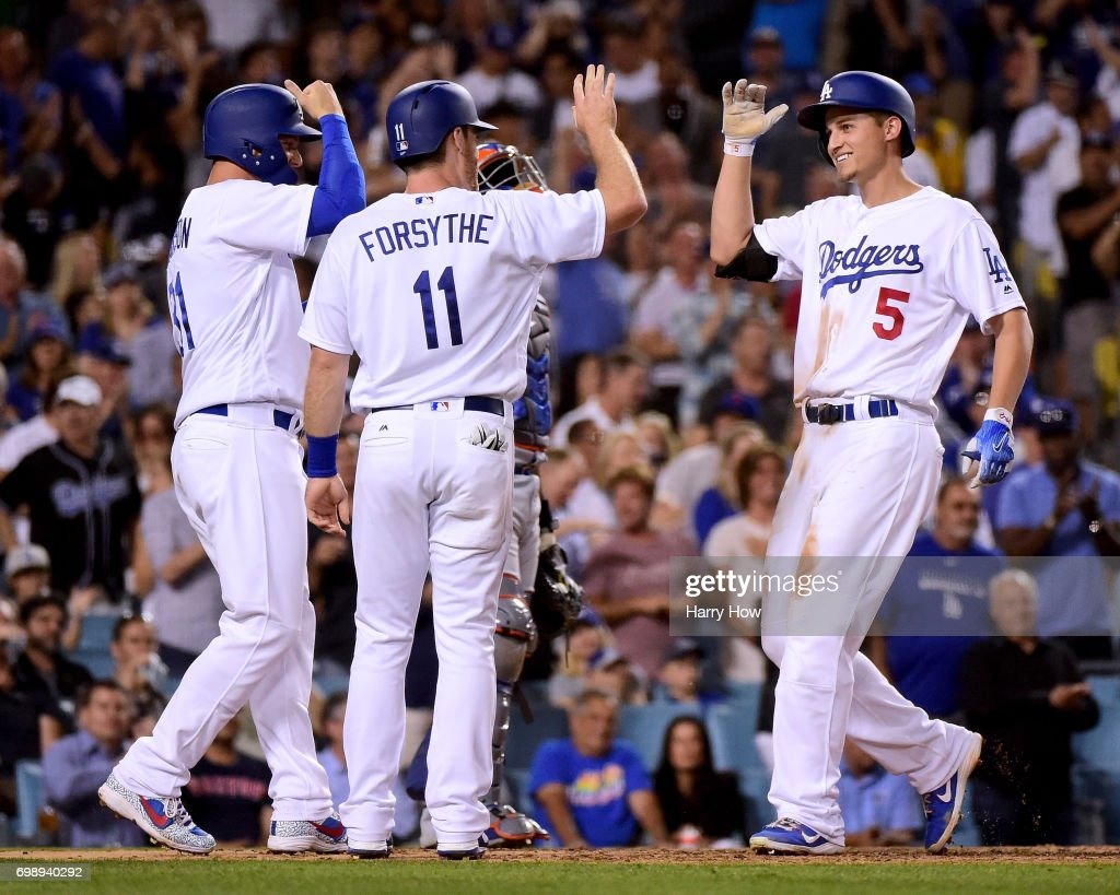 Corey Seager #5 of the Los Angeles Dodgers reacts to his three run homerun with Logan Forsythe #11 and Joc Pederson #31, his third homerun of the game, to take a 10-0 lead over the New York Mets at Dodger Stadium on June 20, 2017 in Los Angeles, California.