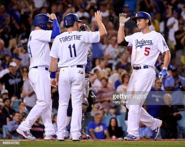 Corey Seager of the Los Angeles Dodgers reacts to his three run homerun with Logan Forsythe and Joc Pederson his third homerun of the game to take a...