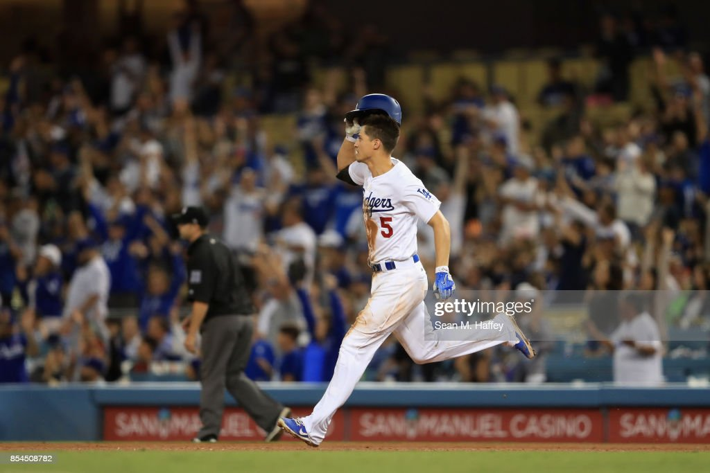 Corey Seager #5 of the Los Angeles Dodgers rounds first base after hitting a three-run homerun during the seventh inning of a game against the San Diego Padres at Dodger Stadium on September 26, 2017 in Los Angeles, California.