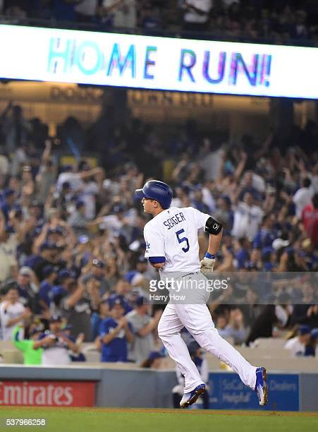 Corey Seager of the Los Angeles Dodgers runs to third after hitting his third homerun of the game to take a 42 lead over the Atlanta Braves during...