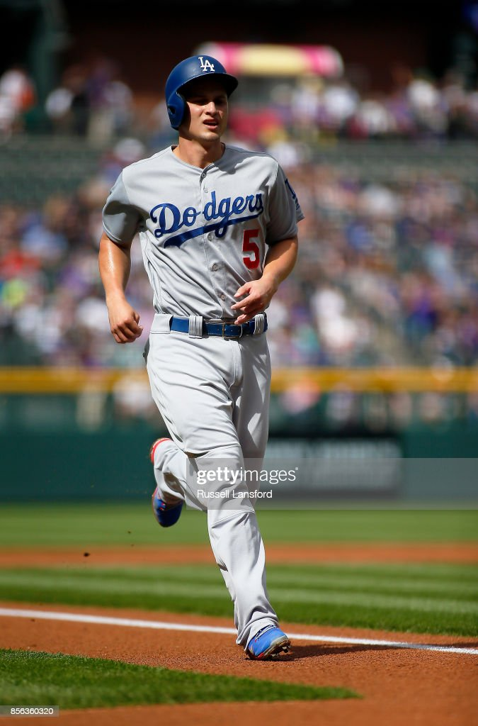 Corey Seager #5 of the Los Angeles Dodgers scores on a ground-rule double by Cody Bellinger (not pictured) during the first inning of a regular season MLB game against the Colorado Rockies at Coors Field on October 1, 2017 in Denver, Colorado.