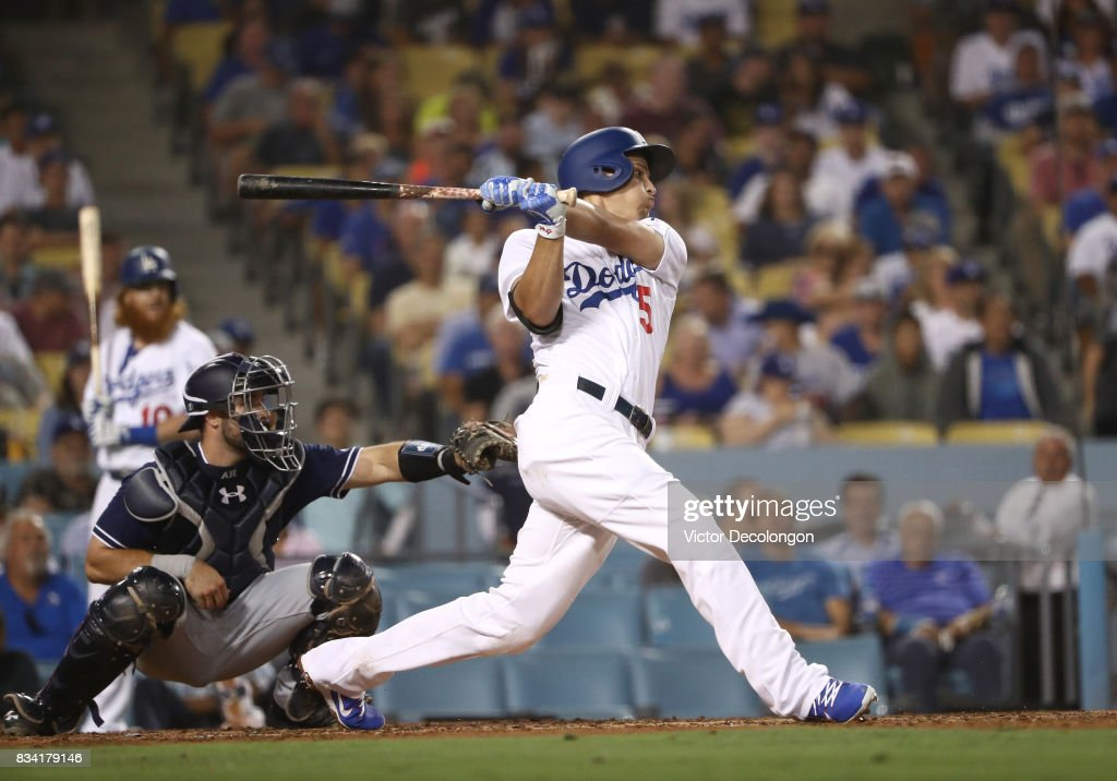Corey Seager #5 of the Los Angeles Dodgers singles to left field during the third inning of the MLB game against the San Diego Padres at Dodger Stadium on August 11, 2017 in Los Angeles, California. The Padres defeated the Dodgers 4-3.
