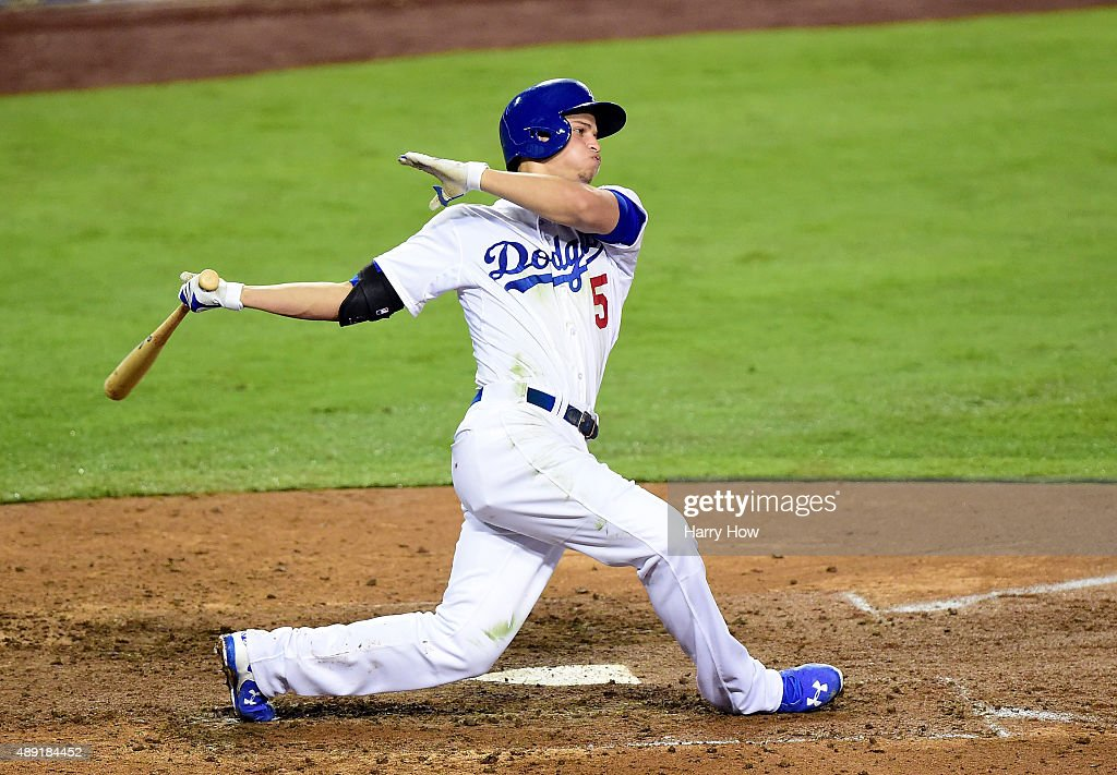 Corey Seager #5 of the Los Angeles Dodgers takes a swing during the seventh inning against the Colorado Rockies at Dodger Stadium on September 15, 2015 in Los Angeles, California.