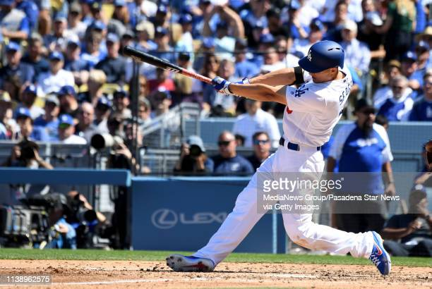 Corey Seager of the Los Angeles Dodgers watches his home run against the Arizona Diamondbacks in the fourth inning of a MLB baseball game during...