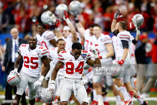 Corey Smith of the Ohio State Buckeyes celebrates with his teammates after defeating the Alabama Crimson Tide during the All State Sugar Bowl at the...
