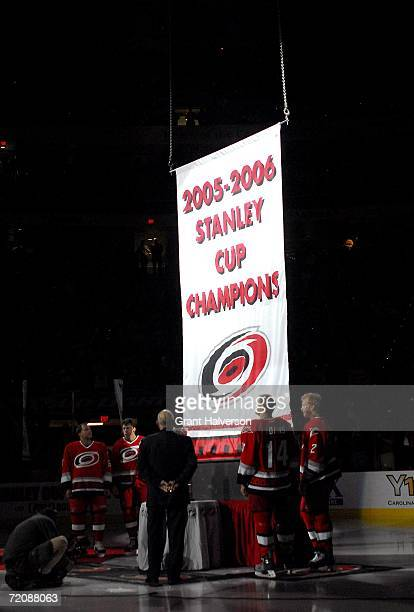 Corey Stillman Rod Brind'Amour owner Peter Karmanos Kevyn Adams and Glen Wesley of the Carolina Hurricanes watch as the 20052006 Stanley Cup banner...