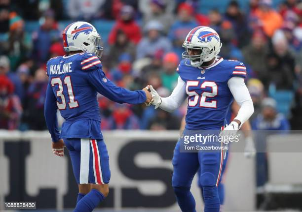 Corey Thompson of the Buffalo Bills shakes hands with Dean Marlowe moments before the opening kick-off of their NFL game against the Miami Dolphins...