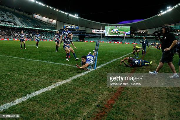 Corey Thompson of the Bulldogs scores his second try in the match against Roosters during the round 21 NRL match between the Canterbury Bulldogs and...