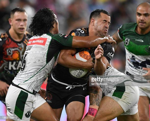 Corey Thompson of the Indigenous All Stars is tackled by Jarome Luai of the Maori All Stars during the NRL All Stars game between the Indigenous and...