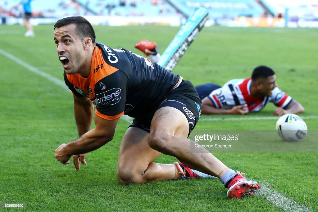 Corey Thompson of the Tigers celebrates scoring a try during the round one NRL match between the Wests Tigers and the Sydney Roosters at ANZ Stadium on March 10, 2018 in Sydney, Australia.