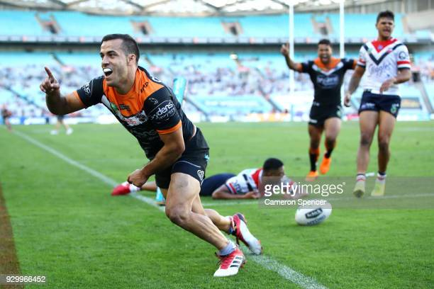 Corey Thompson of the Tigers celebrates scoring a try during the round one NRL match between the Wests Tigers and the Sydney Roosters at ANZ Stadium...