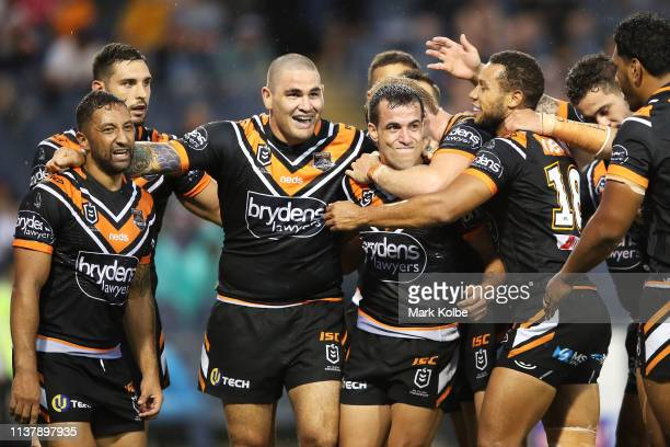 Corey Thompson of the Tigers celebrates with his team mates after scoring a try during the round two NRL match between the Wests Tigers and the New...