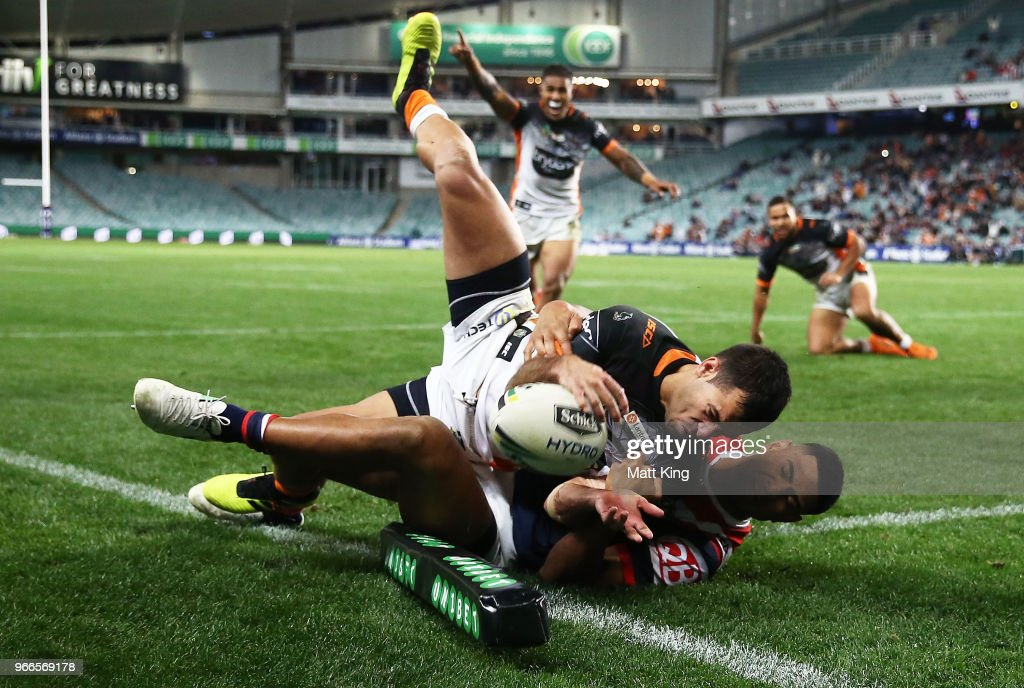 Corey Thompson of the Tigers is tackled over the line in the corner by Daniel Tupou of the Roosters in the final minutes during the round 13 NRL match between the Sydney Roosters and the Wests Tigers at Allianz Stadium on June 3, 2018 in Sydney, Australia.