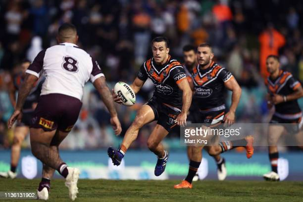 Corey Thompson of the Tigers takes on the defence during the round 1 NRL match between the Wests Tigers and the Manly Warringah Sea Eagles at...