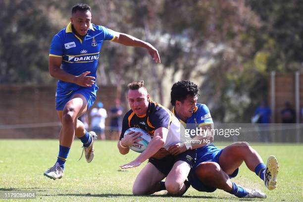 Corey Toole of the Brumbies is tackled during the round 2 National U19s Championship match between Brumbies URC and Sydney URC at the Australian...