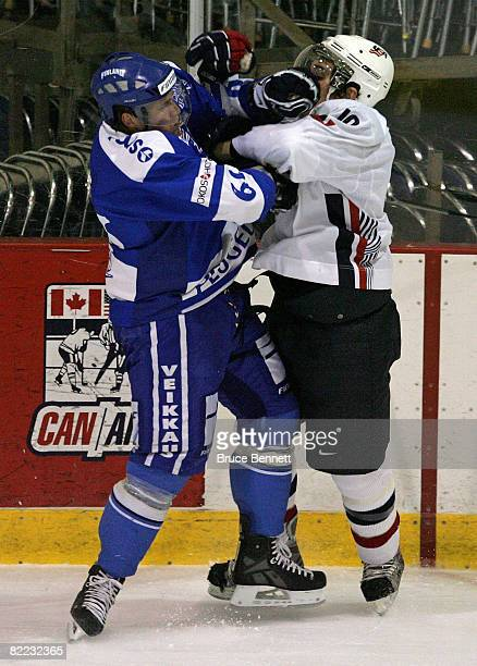 Corey Tropp of Team USA collides with Nestori Lahde of Team Finland at the USA Hockey National Junior Evaluation Camp on August 9, 2008 at the...