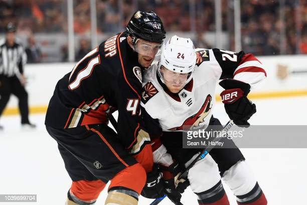 Corey Tropp of the Anaheim Ducks battles Hudson Fasching of the Arizona Coyotes during the second period of an NHL preseason game at Honda Center on...