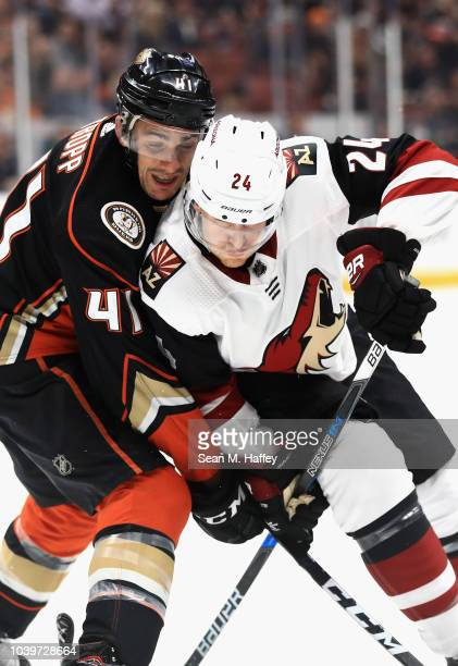 Corey Tropp of the Anaheim Ducks defends against Hudson Fasching of the Arizona Coyotes during the second period of an NHL preseason game at Honda...