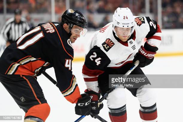 Corey Tropp of the Anaheim Ducks pushes Hudson Fasching of the Arizona Coyotes during the second period of an NHL preseason game at Honda Center on...