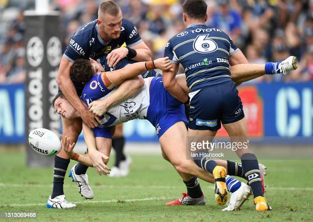 Corey Waddell of the Bulldogs offloads the ball during the round six NRL match between the North Queensland Cowboys and the Canterbury Bulldogs at...