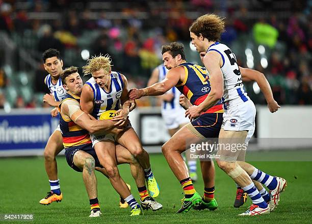 Corey Wagner of the Kangaroos is tackled during the round 14 AFL match between the Adelaide Crows and the North Melbourne Kangaroos at Adelaide Oval...