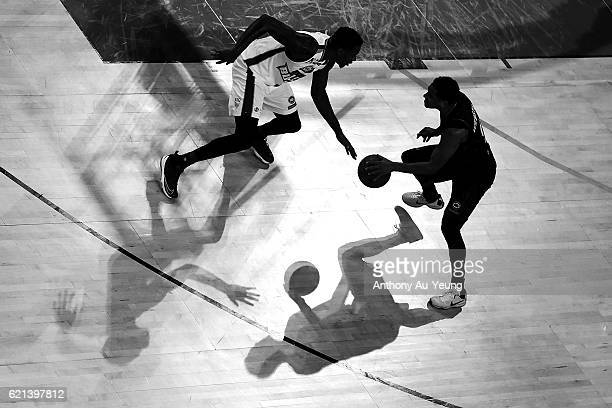 Corey Webster of New Zealand competes against Torrey Craig of Brisbane during the round five NBL match between the New Zealand Breakers and the...