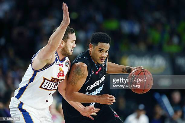 Corey Webster of New Zealand drives against Adam Gibson of Brisbane during the round five NBL match between the New Zealand Breakers and the Brisbane...