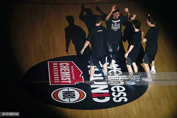 Corey Webster of New Zealand runs out during the players introduction prior to the round one NBL match between the New Zealand Breakers and Melbourne...
