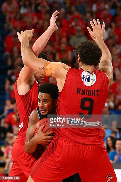 Corey Webster of the Breakers attempts pass th eball against Damian Martin and Matt Knight of the Wildcats during game three of the NBL Grand Final...