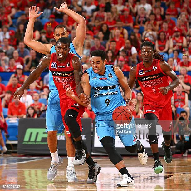 Corey Webster of the Breakers dribbles up the court against Casey Prather of the Wildcats during the round six NBL match between the Perth Wildcats...