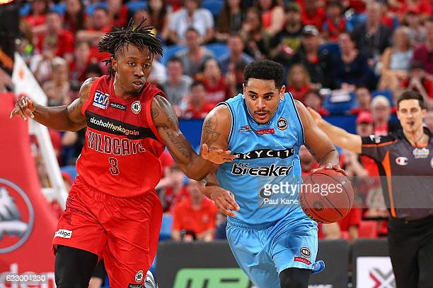 Corey Webster of the Breakers dribbles up the court against Jaron Johnson of the Wildcats during the round six NBL match between the Perth Wildcats...