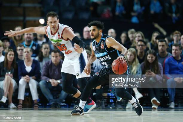 Corey Webster of the Breakers drives against Alex Loughton of the Taipans during the round five NBL match between the New Zealand Breakers and the...