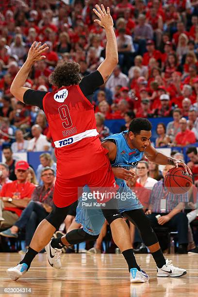 Corey Webster of the Breakers drives past Matt Knight of the Wildcats during the round six NBL match between the Perth Wildcats and the New Zealand...
