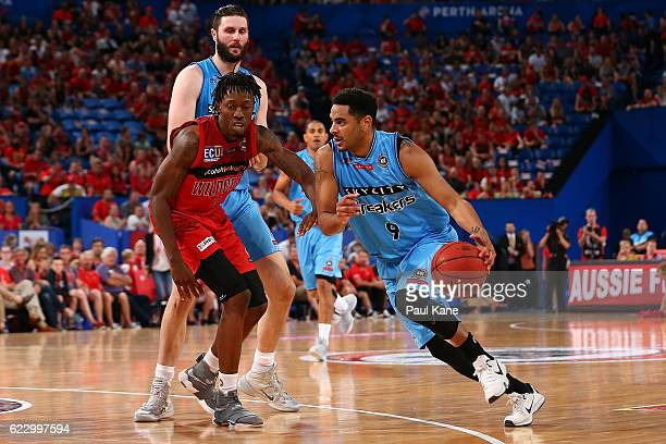 Corey Webster of the Breakers drives to the basket against Jaron Johnson of the Wildcats during the round six NBL match between the Perth Wildcats...