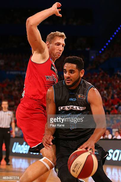 Corey Webster of the Breakers drives to the basket against Shawn Redhage of the Wildcats during the NBL round 19 game between the Perth Wildcats and...