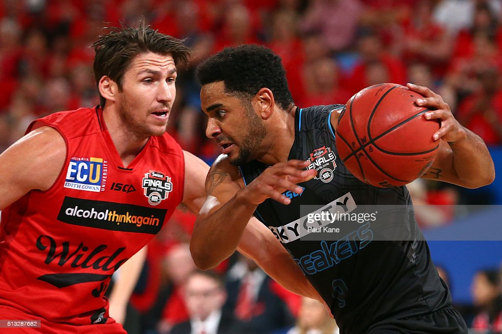 Corey Webster of the Breakers looks drive past Damian Martin of the Wildcats during game one of the NBL Grand FInal series between the Perth Wildcats and the New Zealand Breakers at Perth Arena on March 2, 2016 in Perth, Australia.