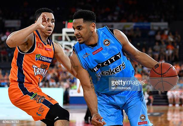 Corey Webster of the Breakers looks to get past Travis Trice of the Taipans during the round eight NBL match between the Cairns Taipans and the New...